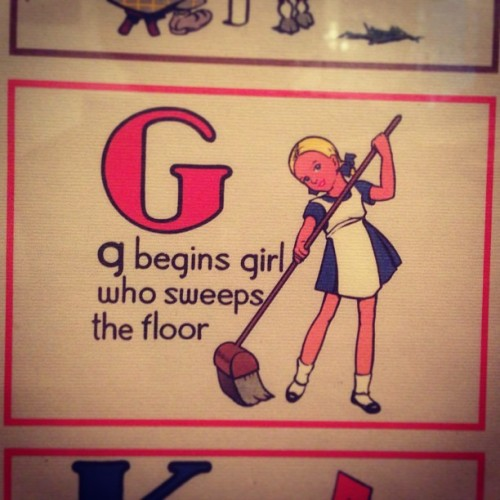 Girl sweeps floor