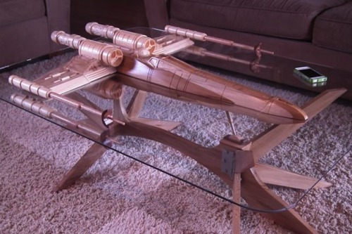 Ron Swanson X George Lucas' Disney's Star Wars X-Wing Fighter Table This X-Wing table is not only beautiful and artistic but it will hold your beers, phones, and books just fine. Coming in at roughly $60,000 I would say it's more than worth it. This Sean Regan and Aubrey Cohen piece takes 6 months to carve. I think I'm going to put in my order now…