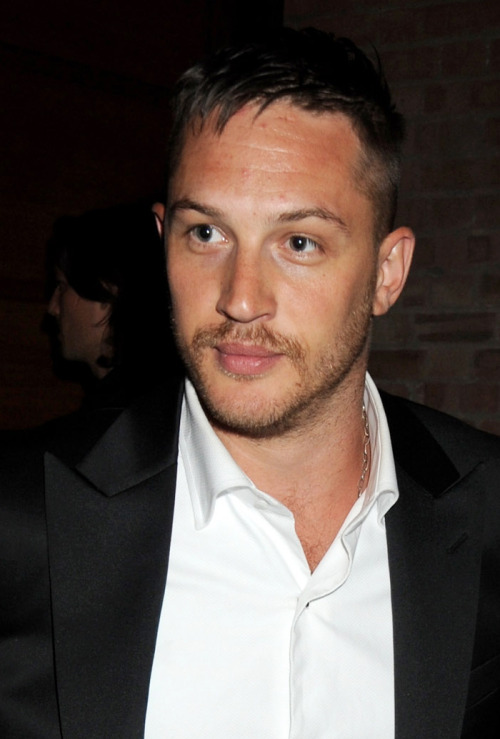 tomhardyvariations:  A fresh closeup from the Rocknrolla premiere. Here's Tom talking about Handsome Bobski.     How did you approach playing a gay character in a Guy Ritchie movie? Tom: I think there's an uber stress on being a guy. Guy Ritchie movies, in my opinion, can be very bloke-y in the same way that car magazines or fighting magazines are sort of specifically for the boys. So, Ironically enough, I just played him as straight as possible. So my identification with me and my girlfriend was exactly the same as it was about Bob and One Two, Gerard's character. There was no need to be camp or anything like that. I'm in love with Gerard, and that's it, no big deal. Was there anyone in particular that you modeled the character after? I watched Cool Hand Luke and Midnight Cowboy, you know, with Jon Voight and Paul Newman, and Steve McQueen in The Great Escape. You know, those kind of images that I wanted to find a sort of modern day homage, in a way, discreetly to those three guys. They're all pretty huge sex symbols for gay guys. Well, I also find them incredibly sexy. It made sense to me to do that. I wanted him to be sexy. As sexy as he could be because it's not something that I've ever really explored. The movie is incredibly sexy, but ironically, the actual sex is so minimal. I'm curious how you would have approached a gay sex scene in a Guy Ritchie movie? I think Thandie Newton and Gerard Butler's scene was absolutely brilliant. Very pop art. I think it would have been done the same way. I don't know what Guy would do with a gay sex scene. It'd be really interesting. (x)
