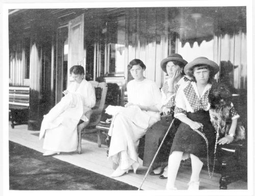 Empress Alexandra and Grand Duchesses Tatiana, Olga, Anastasia, and Alexei's dog Joy aboard the Standart: 1914.