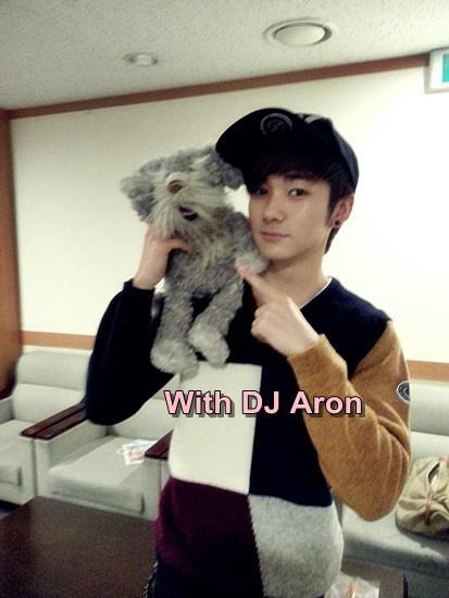 nuest-id:  DJ Arong with Our New mascot Popcorn (cr : DJ Isak FB)