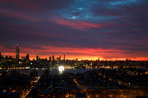 tamturse:  Fiery Sunrise 1 on Flickr. A beautiful sunrise over Manhattan