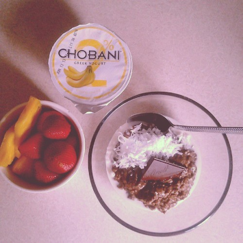 Chocolate chia seed oatmeal w/ shredded coconut and a square of Lindt coconut chocolate. Pineapple. Strawberries. Banana Chobani. [11 p+]