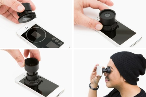 This little periscope-looking thing is a camera eyepiece for your iPhone! The iPhone Viewfinder pretty much gives your phone a viewfinder like the one your other cameras have. It suctions to your phone's screen and works with an app to help you frame your shot. It's especially helpful for shooting on bright days! The iPhone Viewfinder Adds an Eyepiece to Your iPhone