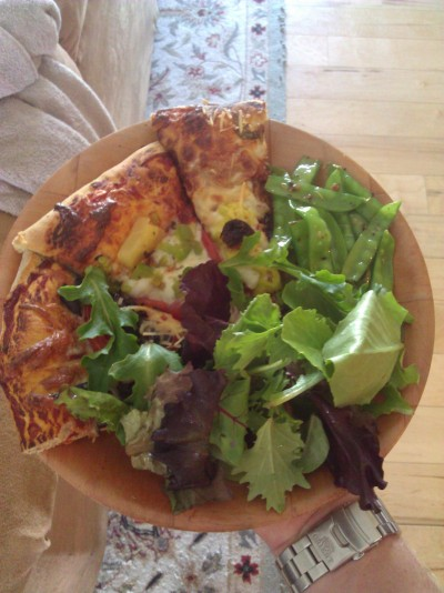 Fresh herb pizzas, freshly picked snap peas from the garden, and a spring mix salad.