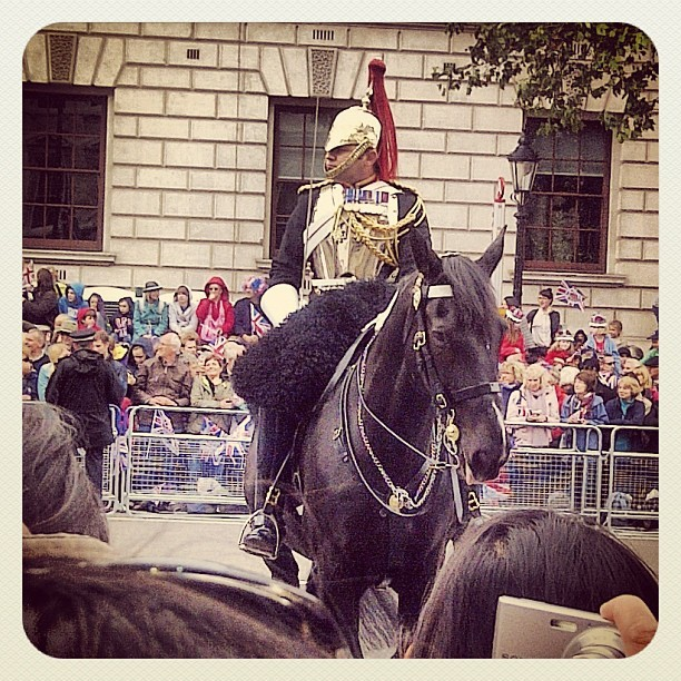 Royal Horseguard in streets of London amongst Jubilee crowds.