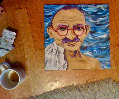 "painting of I did of ghandi for my fatha :} i like painting i've never really done it before but its funnnn"", new hobby perhaps instead of drinking and going on facebook? lololz jk.. kind of"