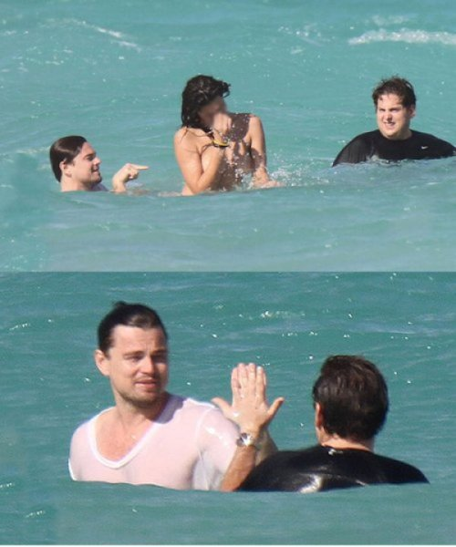 Jonah Hill and Leonardo DiCaprio High Five For Swimming With Topless Woman Someone get them a bromance movie.