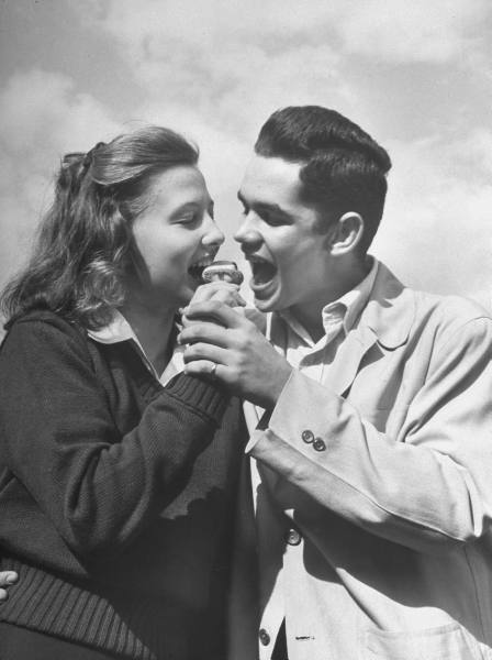 Teens, 1947 Teen couple sharing an ice cream cone life