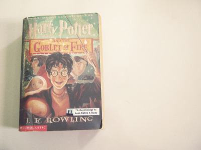 posterkidforhappiness:  My beaten down copy of Harry Potter and the Goblet of Fire. J.K. Rowling's Harry Potter series are among the best books I've ever read in my life. I can totally see it half a century from now in the Classics section of a bookstore. That I even think there will be bookstores 50 years from now is a stretch but some of us could only hope. Nonetheless, in my vivid imagination, the seven books will be there in a bookshelf with the Jane Austens, Shakespeares, George Orwells, and Edgar Allan Poes. It'll be in the reading selection of school children and even, high school students. Because, you can never stop reading them whatever age you are. I can be fifty and I'd still be reading these books again and again.