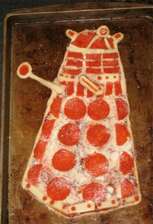 We don't know who made this incredibly awesome Dalek pizza. Because there doesn't seem to be a photo of the pizza taken after it was cooked, we're hoping this deliciously hostile entrée didn't exterminate them before they were able to eat it. This photo was shared on Reddit. If you happen to know who created this menacing pizza pie, please let us know. [via Obvious Winner]