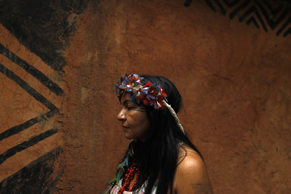An indigenous woman stood in an Indian museum in Rio de Janeiro Tuesday. Squatters who have been living in the abandoned museum are protesting against their impending eviction before the 2014 World Cup in Brazil. A parking lot is planned for the location. Pilar Olivares/Reuters