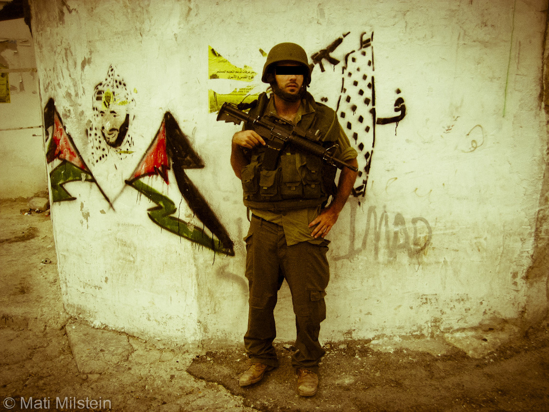 Nablus sector, 2009  An Israeli infantry soldier pauses during a patrol in the northern West Bank.