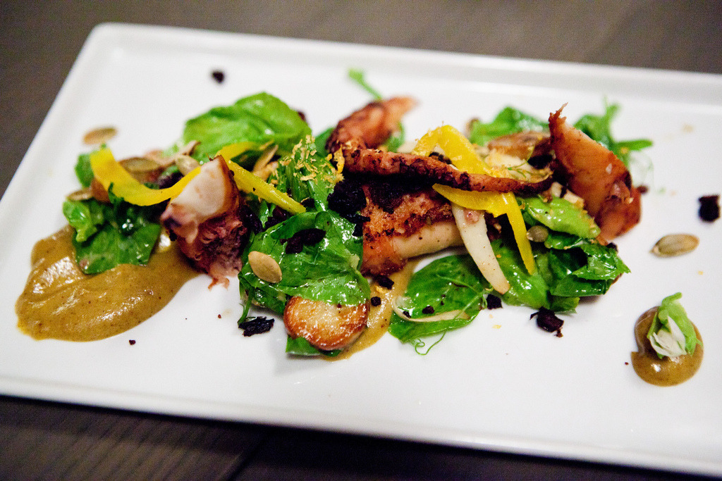 Smoked Octopus crisp new potatoes, hearts of palm, snow pea leaves, crunchy pumpkin seeds, and a date & green olive purée