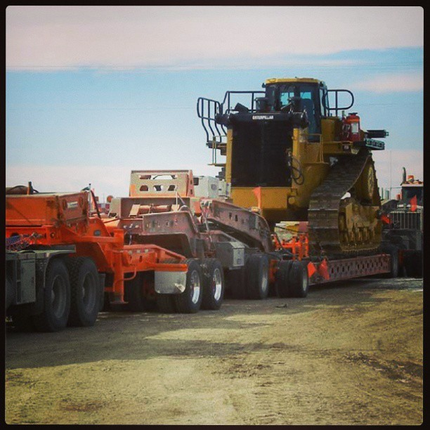 Our D11T bulldozer shipping out on 86 wheels.