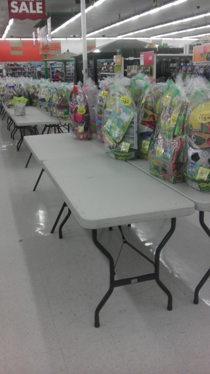 """OK GUYS, IT'S EASTER TIME! BUST OUT THE FOLDING TABLES, STICK THEM IN THE MIDDLE OF THE WALKWAY, AND PUT OUT THOSE PRE-ASSSEMBLED EASTER BASKETS!"" Kmart, ever heard of an ""endcap""?"