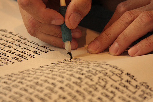 Writing the Torah  Writing some of the last few letters in a torah scroll