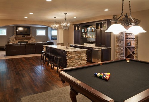 schweet-life:  Basement with warm colors, stone accents, and dark wood by Sensible Home Design (Source: houzz.com)