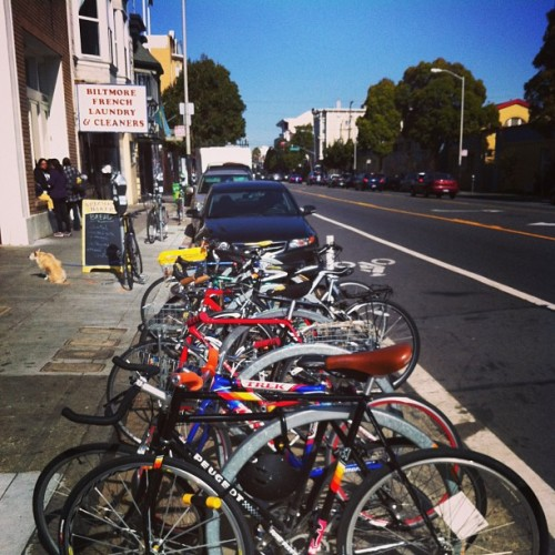 Racks and racks and racks of bike and bikes and bikes in front of Arizmendi. My bike's the Peugeot. #bikes #arizmendi #sf #peugeot  (at Arizmendi Bakery Panaderia & Pizzeria)
