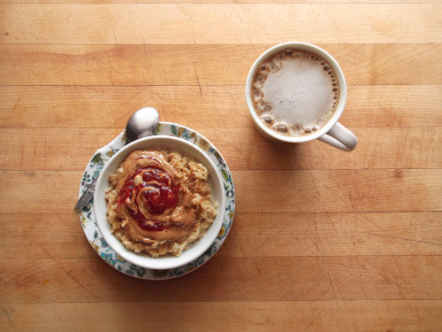 garden-of-vegan:  oatmeal topped with almond butter, strawberry-rhubarb jam, ground flax seed, and agave syrup, and coffee with vanilla soy milk