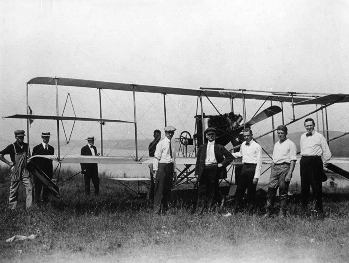 On 8 May 1911, the  Birthday of Naval Aviation, the U.S. Navy ordered its first airplane, a Curtiss Triad (A-1). In this image taken at Hammondsport, New York, June 1911, individuals pose with the A-1, (left to right): Curtiss Mechanic; Dr. A.F. Zahm; Lieutenant J.W. McClaskey, USMC, (Retired); Mr. Jim Lamont; Mr. Glenn Curtiss; Captain Washington I Chambers, USN, Lieutenant John H. Towers, USN; Lieutenant Theodore G. Ellyson, USN; and Mr. Bill Pickens. NHHC image NH 44381.