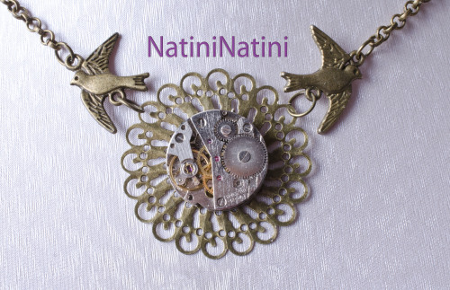vintage watch parts on a gold flower suspended by birds :)  Facebook: https://www.facebook.com/NatiniArt Etsy: https://www.etsy.com/listing/130959448/cradled-clockwork