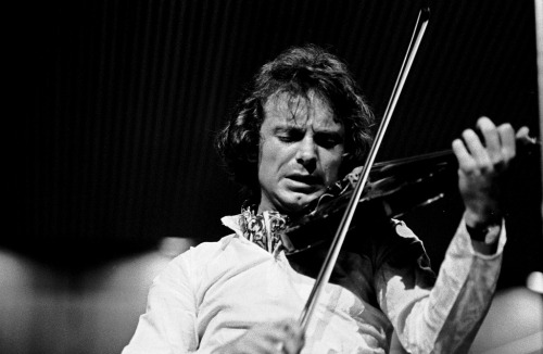 "[Jazz violinist]  Jean-Luc Ponty's long rococo lines helped set the style for jazz rock fusion, via his work with Frank Zappa, who wrote him the album ""King Kong,"" and then the Mahavishnu Orchestra. Ponty drew inspiration from horn players, but he shares one failing with some other jazz violinists: he rarely pauses to take a breath. Even Groucho put the cigar down/took the cigar out once in awhile. - Kevin Whitehead   Photo: Jean-Luc Ponty in 1971"