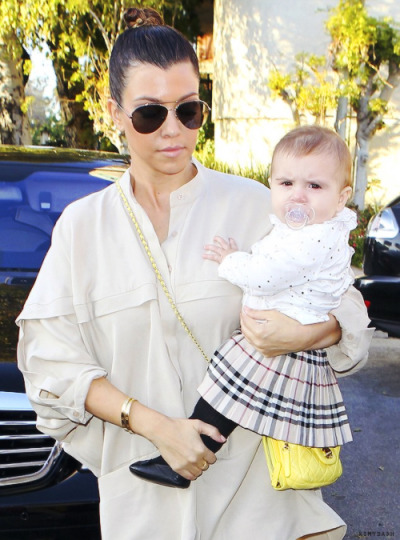 Kourtney Kardashian with daughter Penelope out + about in LA on Wednesday