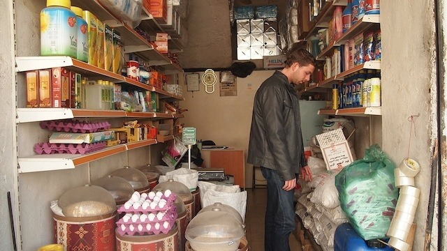 "Wijbe Abma Started a Charity in a Syrian War Zone Kilis, like most border towns, feels like a bastardized, slightly less-racist Wild West: gossip spreads, people pass through, supplies (legal and otherwise) are bought and sold. In this particular border town, however, it feels like that sense of transit is more tangible than in most. Kilis, in southern Turkey, is the gateway to Aleppo, a key battleground in the ongoing conflict in Syria and one of the oldest cities in the world. Unfortunately, with fighting normally including stuff like shells, explosions, and carnage, a good deal of old Aleppo is being devastated. This border town is also the home of Wijbe Abma, a 21-year-old ""freelance"" aid worker. He runs Don't Forget Syria, an idea that started small and has snowballed to a size the founder is not quite comfortable with. It's one man's plan to bring aid directly to civilians within war-torn Aleppo. On his first run, he gave out 100 blankets, but his idea was picked up by the press, donations flooded in, and he now has $17,200 burning a hole in his PayPal account, a logistical clusterfuck to untangle, and the Free Syrian Army (FSA) trying to sell him flour. A few months ago Wijbe was a regular student, traveling home from a year of teaching, drinking shochu, and banging out karaoke in South Korea when he found himself in Antakya in southern Turkey, now home to thousands of Syrians. Here a Syrian man from Aleppo told him about his son who'd been killed by regime shelling. They talked about his troubles and what was left of his city. Like many Syrians, confused and angered by the lack of international assistance, he asked: ""Why won't anyone help?"" Wijbe decided to stop partying and do something. Wijbe selecting blankets. ""It started very small,"" he says. ""I decided to do myself what all of the NGOs had talked about, but none actually seemed to be doing."" The idea was simple; he would walk across the border at Kilis to the makeshift camps in Syria with a couple of blankets in a rucksack, give them out to those in need, and keep traveling. On arrival, he realized the problem was larger than he'd initially thought. The camp was dismissive and Wijbe began to feel powerless when it became apparent that no one would allow him to choose who to help. That autonomy is something Wijbe takes seriously. ""More important than aid that helps is aid that doesn't harm. The only way you know someone isn't taking it all and selling it for weapons is to do it yourself,"" he said. Motivated, he left and founded his own aid project, committing $920 of his savings for the first 100 blankets. A Syrian friend tells me he originally bought one and slept under it for a night to test it. He caught a cold for a week, threw it out and found thicker, warmer blankets. With the help of Syrian civilians he took the blankets to Aleppo and went door to door. Each blanket came with a letter, in Arabic, explaining that it came from an individual with a desire to help and show that someone cared. On the way back their car had a dozen rounds fired at it from a nearby army base, which is a novel way of saying thank you. Continue"