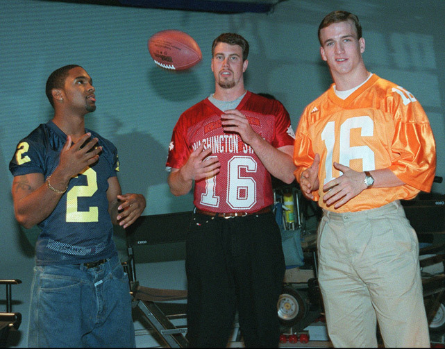 Heisman Trophy winner Charles Woodson talks with Ryan Leaf and Peyton Manning  after shooting a commercial to promote the 1998 NFL Draft. (AP) GALLERY: Rare Photos of The Manning Family