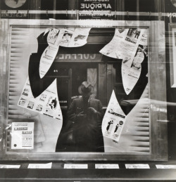 natgeofound:  Photographer's reflection in a cut-out silhouette in a window.Photograph by Maynard Owen Williams, National Geographic