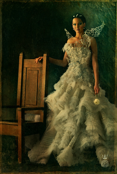 capitolcouture:  Katniss Everdeen shines in her Special Edition Capitol Portrait. See all the portraits this Monday on yours truly, Capitol Couture.