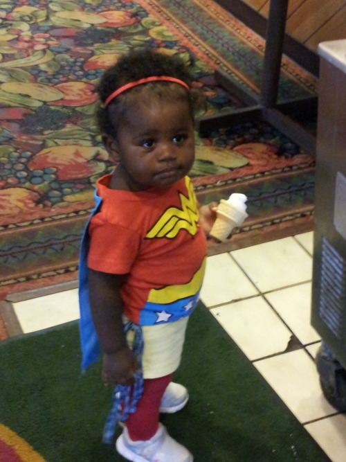 "thehappysorceress:  girlslovesuperheroes:  This is my awesome daughter, Knoxx. She was Wonder Woman for Halloween last year. She adores classic Batman, so much so ""Batman"" was one of her first clear words. You can catch her kicking and punching with her added ""Bam!: and ""Pow!"" sound effects daily. <3  Beautiful and perfect."