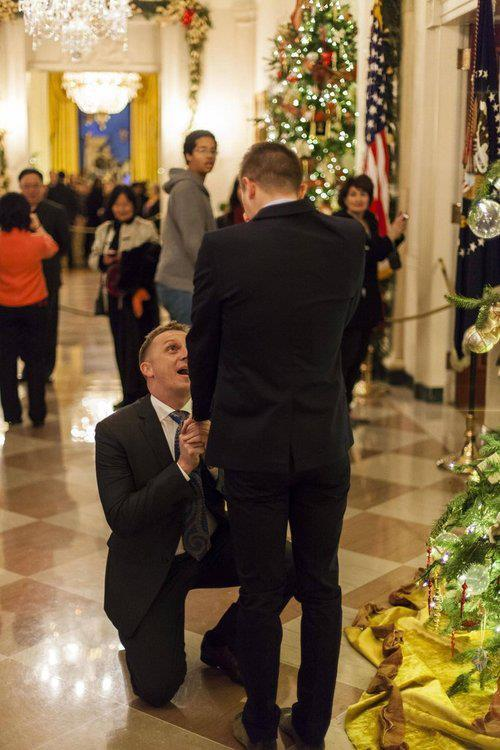 writinginlove:  The first gay marriage proposal in the White House. An active duty U.S. Marine Corps captain made history over the weekend by becoming the first gay man to pop the question to his partner at the White House. In the photo: Matthew Phelps proposing to his partner, Ben Schock. Congrats to the couple, and may their journey be happier than ever.
