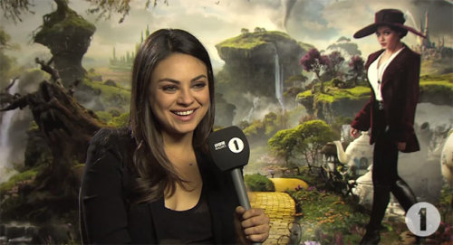 "Mila Kunis Takes Nervous BBC Radio Personality By The Hand And Gives Him The Interview Of His LifeLast we checked in with the lovely Mila Kunis she was reminding us that here native language sounds a lot like Angry Klingon. Now she's back promoting Oz the Great and Powerful across the pond, but more importantly continuing her quest to be undeniably awesome in all situations. Now, I don't know much (read: anything) about BBC Radio 1, ""The Scott Mills Show,"" or interviewer Chris Stark, but my friend Wikipedia tells me Stark has made a personality for himself thanks to endearing obtuseness, which is evident from the second the below video starts rolling."
