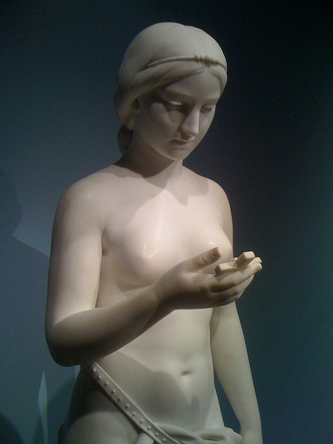 converting the natives on Flickr.During my visit to the Metropolitan museum in NYC I found this statue.  In my mind it sure looks a lot like a person reading their smartphone… (photographed on an iPhone 3G)