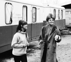 Rita Hayworth and Claudia Cardinale on the set of Circus World, in Madrid, Spain, c. 1964.