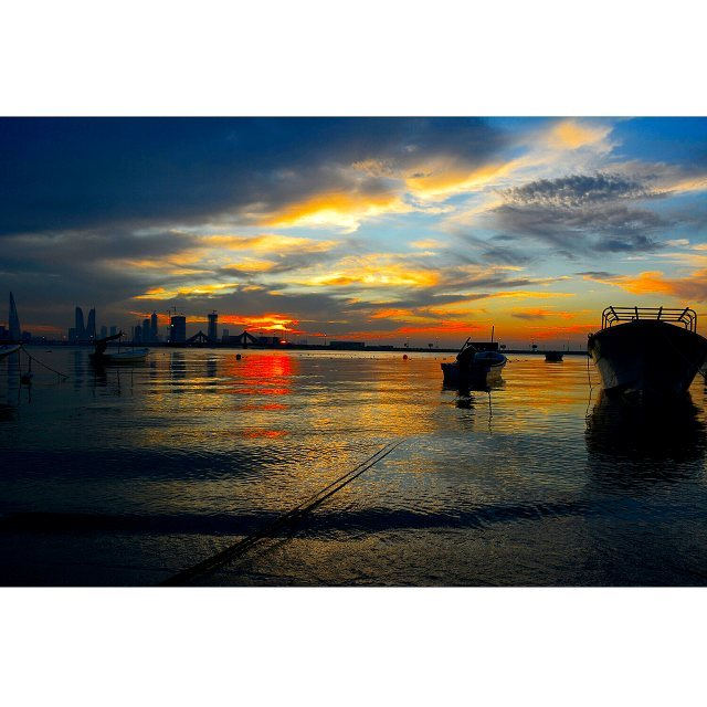 #Sunset #Sky #Sea #Reflection #Shore #Bahrain #2013 #Pudding  #Boats #Buildings #Manama #Skyline #تصويري #البحرين At Al Ghous Corniche