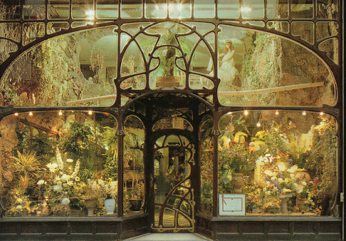 grimogretricks:   Flower-shop, Brussels, designed by Paul Hankar, XIX century.  This is literally the perfect, most fitting sort of thing to put in the window of an Art Nouveau front like this. One of the things I enjoyed about Brussels was the Art Nouveau architecture- not something you see in Britain much.