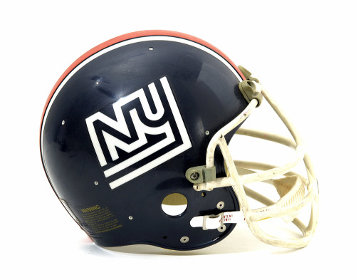 rottenmanzana:  The Lost Logo Of The 1975 New York Giants In 1975, the New York Giants were a team without a country. They were in the wilderness. Their stadium in New Jersey was still being constructed, and the Yankees (the Giants' old landlord) had kicked them out to do renovations. So the Giants had no place to play home games, and to make matters worse, they were terrible. Facing an uncertain future, the team did the only thing they could do. They designed a new logo: an italics-mixed-case-disco-racing-stripe-NY emblem of questionable decision-making. It was the NFL uniform equivalent of a drunk tattoo. It was awesome. And it only lasted for that single season. The Giants ended up playing through the year at Shea Stadium in Queens. In 1976, the team moved in to their home at the Meadowlands, and wasted no time in changing to a logo that was NY/NJ-neutral. It was their banner through two epic Super Bowl victories. [Source - Breadcity.org]