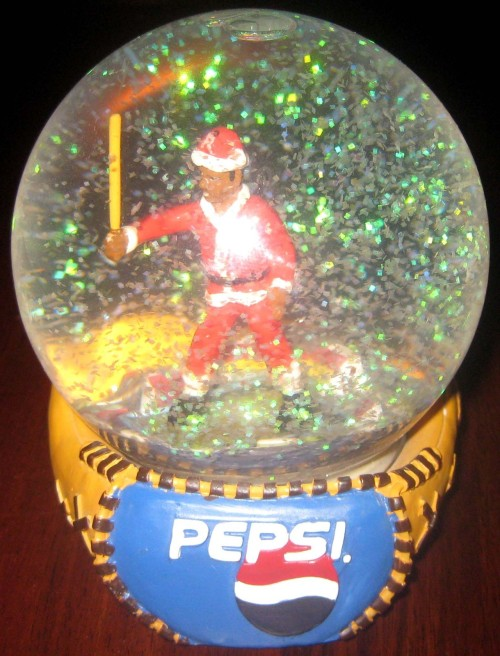 This is a Ryan Howard snowglobe.  It may look like a Willie McGee snowglobe, but I've been assured by higher ups that it's Ryan Howard.  (eBay)