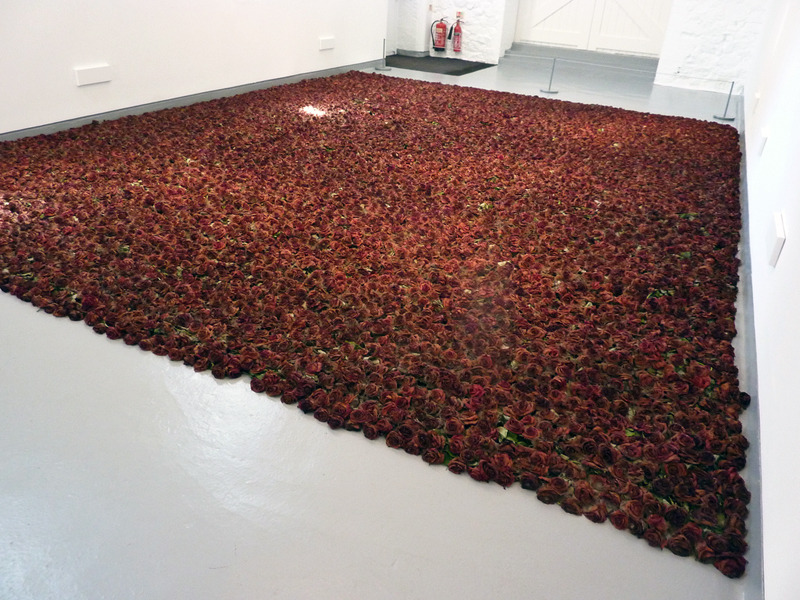likeafieldmouse:  Anya Gallaccio - Red on Green (2012) - The life and death of 10,000 red roses