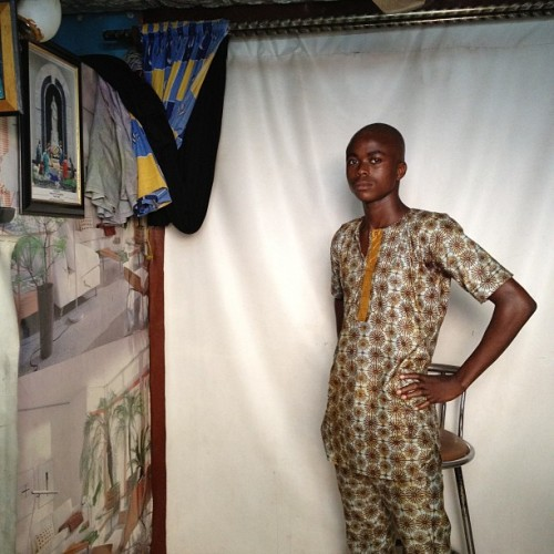 A man gets his portrait taken  at Sammy's Photo Studio in Obalende, a transit hub in Lagos, Nigeria in January. Photo by @glennagordon. #portrait #lagos #nigeria