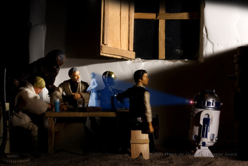 "1/12 | The Calling of Obi-Wan Kenobi on Flickr. Over the past two years I have been overwhelmed with the interest in my various photographic series. When I first began my 365 Days of Clones series, my goal was to create, photographic, edit, and post a new photograph online each day. Similarly, my goal with my 52 Weeks of Star Wars series was to create a new photograph and post it online weekly. This year I have decided to create a monthly series entitled 12 Months of Hope, Empire & Jedi Once again, the goal this year is to simplify my photographic process; quality over quantity. 12 Months of Hope, Empire & Jedi is a series of 12 images that tell the tale of original Star Wars Trilogy through the recreation of historical paintings and photographs. There will be four images for each of the original films; A New Hope, The Empire Strikes Back and Return of the Jedi. Like my 52 Weeks of Star Wars series, 12 Months of Hope, Empire & Jedi will also be creations for my Cloned Photos mini-series.  The first photograph in the series is entitled ""The Calling of Obi-Wan Kenobi"" and is based upon Caravaggio's  The Calling of Saint Matthew. Caravaggio's painting depicts Jesus and Saint Peter entering the room on the far right. I have chosen to depict Artoo entering by himself. Matthew is depicted at the table with a group of men. Although there has been much debate, it is widely accepted that the bearded man with the surprised expression on his face is Matthew. I have replaced Matthew with Obi-Wan as Matthew was being called by Jesus to follow him. Similarly, Obi-Wan was being asked to help Princess Leia with the assistance of Artoo of course. I should note that Princess Leia's hologram is seen twice in the film; once by Luke, Threepio and Artoo and then a second time by Obi-Wan. Although Han and Chewbacca did not see Leia's cry for help, I have decided to add them to the photograph for a couple of reasons. Both characters play very important roles in the rescue of Leia from the Death Star as well as Caravaggio had painted five men sitting at the table, not three.  Enjoy!  Subscribe via RSS 