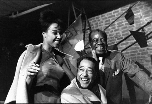 Diahann Carroll, Duke Ellington and Louis Armstrong in Paris in 1960 during the filming of the 1961 movie Paris Blues. Mr. Ellington provided the music for the film and Ms. Carroll starred alongside Paul Newman and Sidney Poitier. Photo by Herman Leonard.