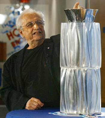 "Celebrity Grave | Frank Gehry's World Cup of Hockey Trophy Bold art always invites a backlash. World class architect Frank Gehry knows a lot about this. Gehry has a commitment to taking risk, and he understands criticism comes with the territory. ""If you show any kind of architecture in early stages that represent anything outside the norm they get clobbered,"" Gehry said in 2012 ""because people say, 'Well, you can't do that,""  His work at the edges of commercial design has made him the most famous architect in the world, but his creative risks have also lead to public embarrassment. In 2004 Gehry was commissioned by the organizers of the World Cup of Hockey to update design of their championship trophy. The original trophy looked like cheesy corporate hood ornament, and Gehry was hired to build prize befitting of the 21 century. For Gehry, Toronto-born and lifelong hockey fan, the pressure was on.   ""I had no idea of what I was getting myself into,"" Gehry confessed during a press conference at Toronto's Hockey Hall of Fame. ""We only just made the deadline by the skin of our teeth. But I'm thrilled to be part of this.""  Leading up to the project, Gehry was at the top of his fame. His 1997 curving titanium design for the Guggenheim gallery in Bilbao Spain, was an undisputed triumph. Critic Paul Goldberger celebrated the it saying ""The building blazed new trails and became an extraordinary phenomenon. It was one of those rare moments when critics, academics, and the general public were all completely united about something.""  Gehry seemed like a safe choice for the redesign. After all, he was the most famous architect at the time. However, when the trophy was unveiled. Dead silence followed.  Journalists were confused. Tradition-obsessed hockey fans were aghast.The trophy was not what they expected. To begin with, it looked nothing like the Stanley Cup.  Online comments mocked,""The Fruit goes in here, and it makes the freshest, tastiest, healthiest juice you've ever tasted! BUT THATS NOT ALL!!!.."" Poor reviews where posted in Canada's largest newspapers.  Gehry, a Toronto native and lifelong hockey fan himself, was aware the trophy looked nothing like the Stanley Cup. He approached the project with the same boldness that made the Bilao gallery look nothing like a conventional home for art. He offered a minimalist silver cup, embedded in a multi faceted translucent base. The chosen materials represented, obviously, the metal blades of the hockey skates cutting through the ice. The silver cup was removable and each year, the names of the winning players would be engraved on the cup and embedded in the glacier-like holder, preserving the names for all time.   Gehry handled the reaction to the design with grace. ""I can tell you don't like it,"" Gehry joked. No one was laughing. Bravely, Gehry's patrons stood by him. Ken Jaffe of the NHL and the WCH Organizing Committee said Gehry ""gladly accepted the assignment and vigorously developed a great looking icon for the game."" No changes were made to the design.  The trophy unveiling was a failure. Had Gehry decided to play it safe, he could have designed a traditional-looking trophy and had a more pleasant press conference. But doing so would have disappointed his real fans, the people who love him because takes risks. As marketer Seth Godin would say, ""If you cater to normal, you will disappoint the weird."""