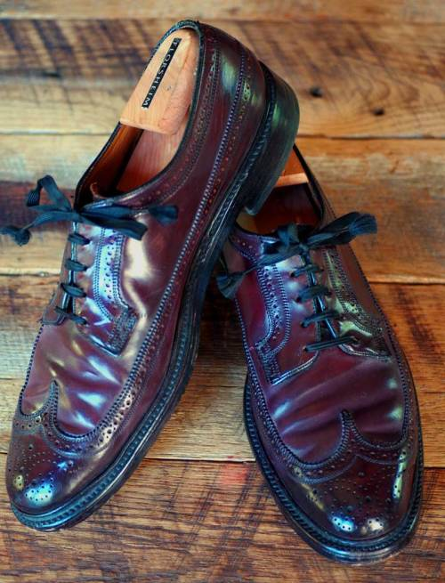 "How About Some Vintage Florsheims? Florsheim may still be the most famous men's dress shoe brand in the United States. For decades, ""The Florsheim Shoe"" was the standard for the American business man. My grandfather wore Florsheims to his job at Fox Theaters, and your grandfather may well have worn them to his job, too. Somewhere along the line, though, Florsheim shipped production overseas and started using low-quality leather. Head into a Florsheim shop today and for the most part, you'll find corrected grain shoes, made in India or other points abroad. They've made a few moves towards restoring quality, with the Goodyear-welted Veblen model and a designer collaboration with crazy-color-enthusiasts Duckie Brown, but they still don't make great shoes. But as a reader named David reminded me when Derek posted his affordable shoes roundup, the vintage models are still a great value. These are genuinely classic shoes - unchanged in design for sixty or seventy years. Often they were made in shell cordovan - like my pair, pictured above - and with heavy double soles, they last forever. Enthusiasts look for the v-cleat, a small metal piece in the heel which protects it from wear. Be warned, though, that while it does indeed protect your heel from wear, it doesn't protect you from falling on your rear when walking on a hard, smooth surface like marble, and it certainly won't protect your wood floors from getting beat up by metal. Vintage Florsheim Imperials and Royal Imperials are rife on eBay and in thrift and vintage shops. They were popular and essentially never changed in their design, so they can be found pretty readily. Watch out for damage around the eyelets, where the leather can stretch and sometimes tear, and try to look for barely-worn or unworn pairs. Prices generally range from $50 or so for pebble-grain calf to a hundred or two for shell cordovan in great condition. Buy a pair, and wear it for the next fifty years."