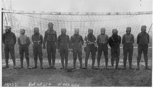 weirdvintage:  Soccer team of British soldiers with gas masks, somewhere in Northern France during World War I, 1916 (via Retronaut)