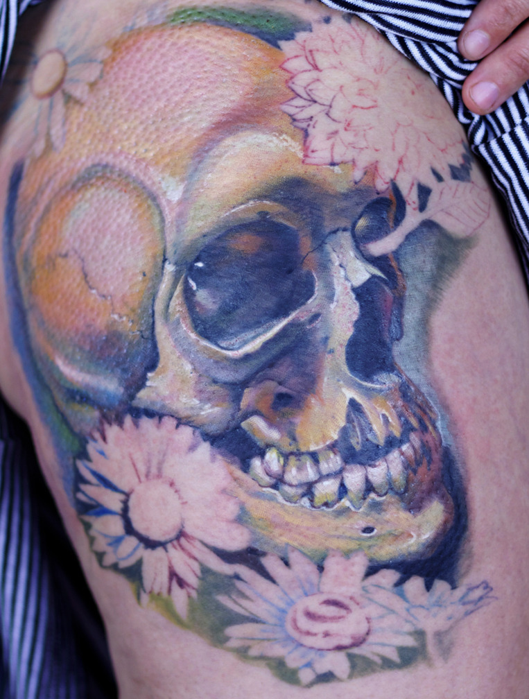 gravenimagetattoo:  Alicia's skull with flowers thigh tattoo in progress. Artist: Paco Dietz   Studio: Graven Image Tattoo, Santa Clara CA