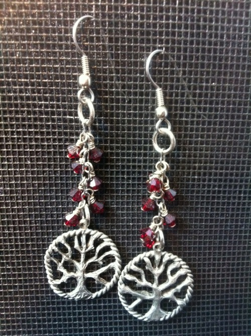 witherblisterburnpeel:  Tree of Life earrings with dark red Swarovski crystals. Made by me.